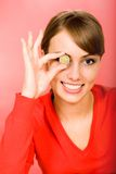 Woman holding coin Royalty Free Stock Photos