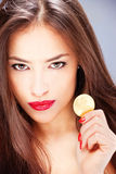 Woman holding coin, ducat Royalty Free Stock Photos