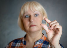 Woman holding coin. Stock Photos