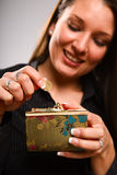 Woman holding coin purse Stock Images