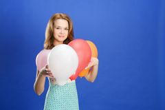 Woman holding color balloons Stock Photos