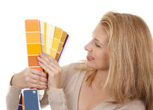 Woman holding color chart Royalty Free Stock Images