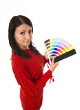 Woman holding color guide. Stock photo of a young woman holding color guide stock photography