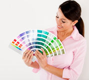 Woman holding a color scale guide Royalty Free Stock Photography