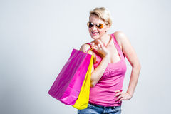 Woman holding colored shopping bags Stock Image