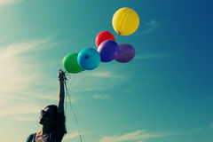 Woman holding colorful balloons Stock Photography
