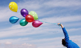 Woman holding colorful balloons Royalty Free Stock Photography