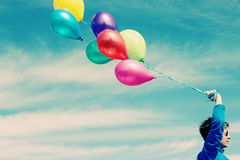 Woman holding colorful balloons Royalty Free Stock Photo