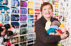 Woman holding colorful knitting yarns Royalty Free Stock Photography