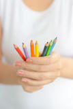Woman holding colorful pencils in hand Royalty Free Stock Images