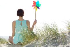 Woman holding colorful pinwheel Royalty Free Stock Image