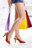 Woman holding colorful shopping bags Royalty Free Stock Images