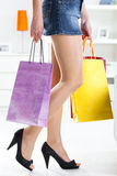 Woman holding colorful shopping bags Royalty Free Stock Photos