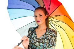 Woman is holding a colorful umbrella. She is blonde and beautifu Royalty Free Stock Photos