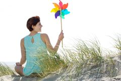 Woman holding colorful windmill toy Royalty Free Stock Image
