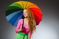 Woman holding colourful umbrella Royalty Free Stock Photo