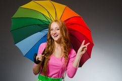 Woman holding colourful umbrella Royalty Free Stock Images