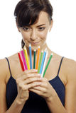 Woman holding colouring pencils Stock Images