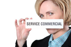 Woman holding commercial servicesign Stock Photo