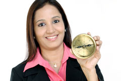 Woman holding a compass stock photography