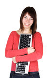 Woman holding computer keyboard and smiling Stock Photos