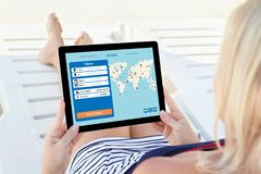 Woman holding computer tablet with application search air ticket stock photo