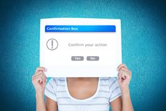 Woman holding confirmation box sign in front of face. Digital composite of Woman holding confirmation box sign in front of face Royalty Free Stock Images