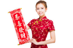 Woman holding a congratulation reel. happy chinese new year Royalty Free Stock Photography