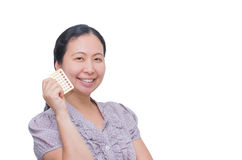 Woman holding contraception pills Stock Photo