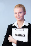 Woman holding a contract on a clipboard Royalty Free Stock Photos