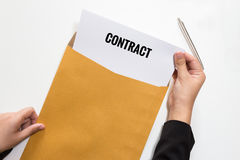Woman holding contract document in envelope Stock Photos