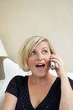 Woman holding cordless phone. Woman holding a cordless phone receiver Royalty Free Stock Images