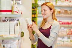 Woman holding cosmetics in hand Stock Images