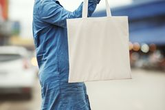 woman holding cotton bag for shopping. eco royalty free stock photos