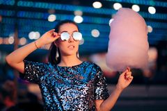 Woman Holding Cotton Candy Dessert in Amusement Park stock photography