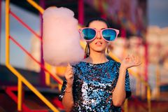 Woman Holding Cotton Candy Dessert in Amusement Park stock image