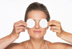 Woman holding cotton pads in front of eyes Royalty Free Stock Image