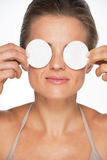 Woman holding cotton pads in front of eyes stock photo