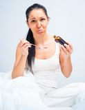 Woman  holding a cough syrup bottle Royalty Free Stock Image