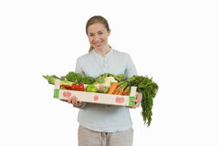 woman holding crate of fruit and vegetables, cut out Royalty Free Stock Images