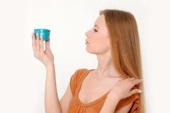 Woman holding  cream Stock Photo