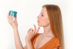 Woman holding  cream Stock Image