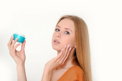 Woman holding  cream Royalty Free Stock Image