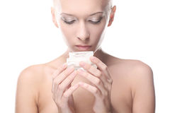 Woman is holding a cream in her hands Royalty Free Stock Images