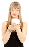 Woman holding a cream jar Royalty Free Stock Image