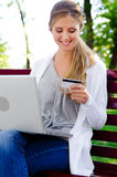 Woman holding credit card Royalty Free Stock Images