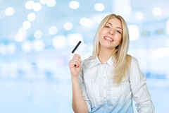 Woman holding credit card Royalty Free Stock Image