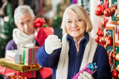 Woman Holding Credit Card At Christmas Store Stock Images