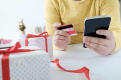 Woman holding credit card and doing shopping online. New year, Christmas gift shopping Stock Photos
