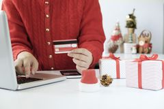 Woman holding credit card and doing shopping online. New year, Christmas gift shopping Royalty Free Stock Images